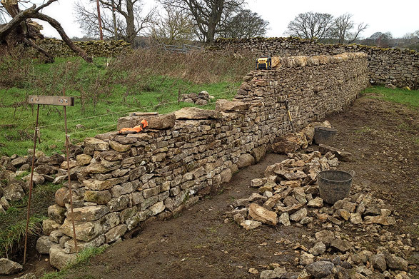 dry stone wall being constructed from reclaimed limestone walling stone in Eden Valley, Cumbria.